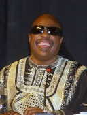Stevie Wonder laughs shades kaftan